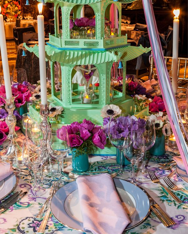 Colorful streamers, lovely lavender service plates by Bernardaud and classic Christofle silver accessories were the finishing touches bringing the essence of spring to the table.