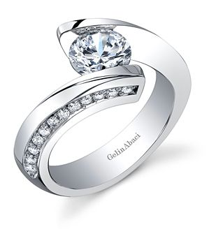 Gelin Abaci Tension Collection platinum engagement ring in bypass platinum tension design set with 0.38-carat pavé diamonds.