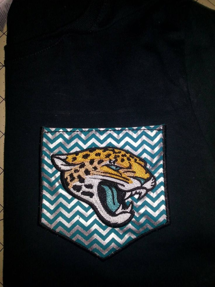 Jacksonville Jaguar Shirt for Gameday. Applique Pocket T-shirt. Custom NFL Shirt. Other Teams Available. Woman's or mans nfl shirt by PearlsAndBowtiesJax on Etsy https://www.etsy.com/listing/205151039/jacksonville-jaguar-shirt-for-gameday