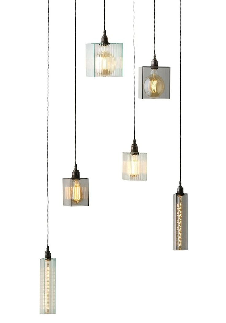 Modern, angular lines sharpen inner reflections of the filament displayed in The Cotton Mill pendant