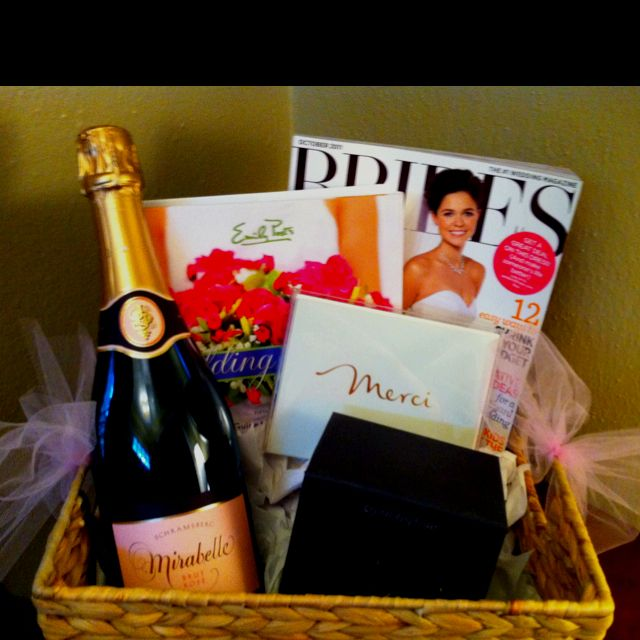 Happy engagement gift!  Bridal magazines, wedding etiquette book, pink champagne, thank you notes, and ring holder.