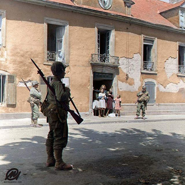"""the_ww2_memoirs US Gliderborne soldiers of the 327th GIR (Glider Infantry Regiment) 101st Airborne """"Screaming Eagles"""", patrol through the battered streets of Carentan during the fighting that took place there, Normandy, France, 12-14th of June, 1944. Glider troops are often overshadowed by the paratroopers but their job was just as essential and dangerous as any others. They had to glide, under fire, in a wood and canvas WACO glider, survive the landing, and then jump out into a hailstorm of…"""