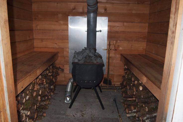 the inside of the sauna has a new replacement wood burning