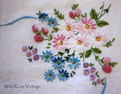 Vintage embroidery - floral sampler with raspberries. Love the berry textures.