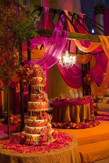 Sweetheart table for Indian bride & groom. Orange and Pink Wedding