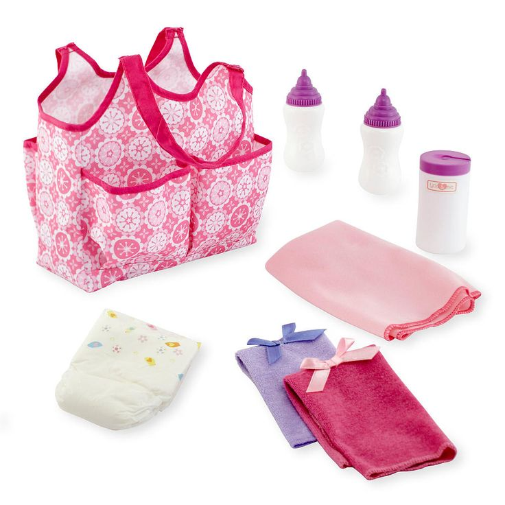 """This You & Me Doll Accessories Tote Bag, a Toys 'R' Us exclusive, makes it easy to take your baby doll anywhere. The nine-piece set includes two bottles, one diaper, two soft clothes, a changing blanket, and a container for baby wipes. Everything fits neatly into the pretty, bright pink tote, which can be carried on one shoulder, leaving both of your hands free to take care of your baby doll. Dimensions: 7L x 4.5""""W x 5D. Weight: 7.5 oz.<br><br><b>You & Me</b> baby dolls, baby doll clothes…"""