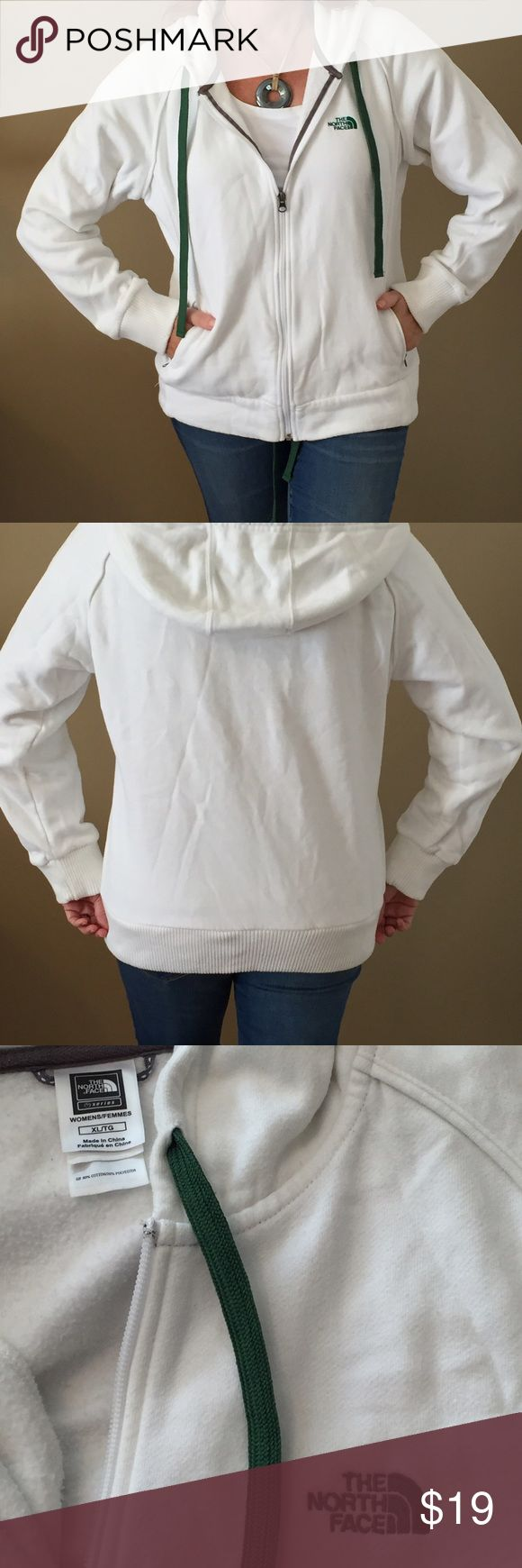 White North Face hoodie You can never really have too many hoodies! This cozy white North Face Jacket has zippered side pockets and ribbed cuffs. It's an extra large, but if you like your jackets roomy then it's more like a medium- large. Clean and in excellent condition North Face Jackets & Coats