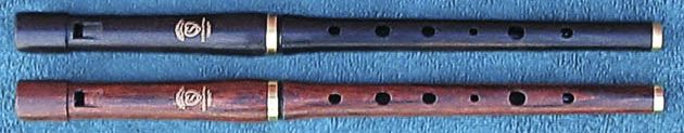 Since my new years resolution is to pick up music again, my life-long wish to learn how to play a low D Irish whistle is now out on the open. ;)  Gotta start with a high D one though (to learn) and I loooove the wooden ones. The Rosewood one here is amazing looking.