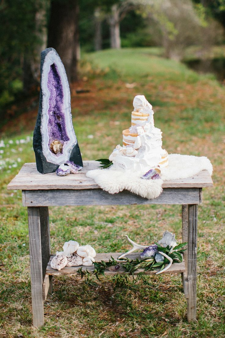 Geode wedding decor, crystal wedding cake. Geodes are just so darn purty. Cake by Tiffany's Baking Co., geode from Enter the Earth, furniture by East West Vintage Rentals, photography by Michelle Lyerly Photography