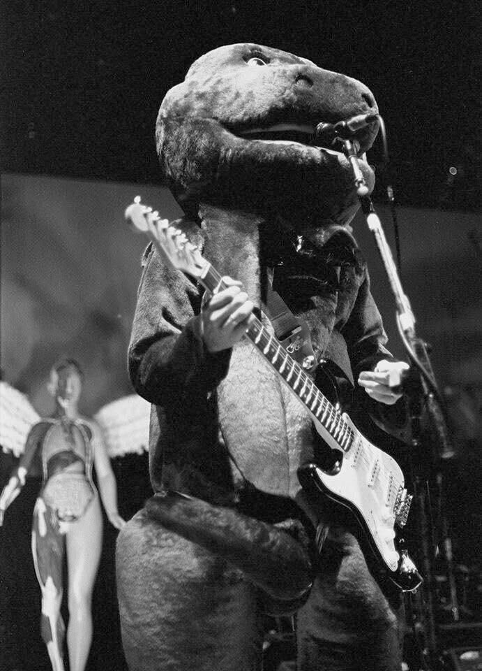 Kurt Cobain performing live in a Barney costume on Halloween night in Akron Ohio 1993 http://ift.tt/2vhYj5B