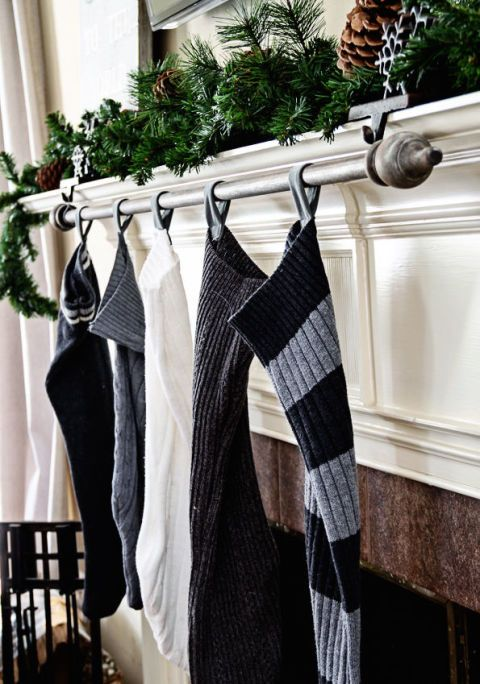 If there's no room on your mantle for, say, sixstocking holders (or you've already filled it up with other decor) opt foran inexpensive curtain rod — in this example from Maison de Pax, the rod is made of reclaimed wood.Sting your stockings, hang the rod withjust two stocking holders and wire, and deemyourself a brilliant space saver.