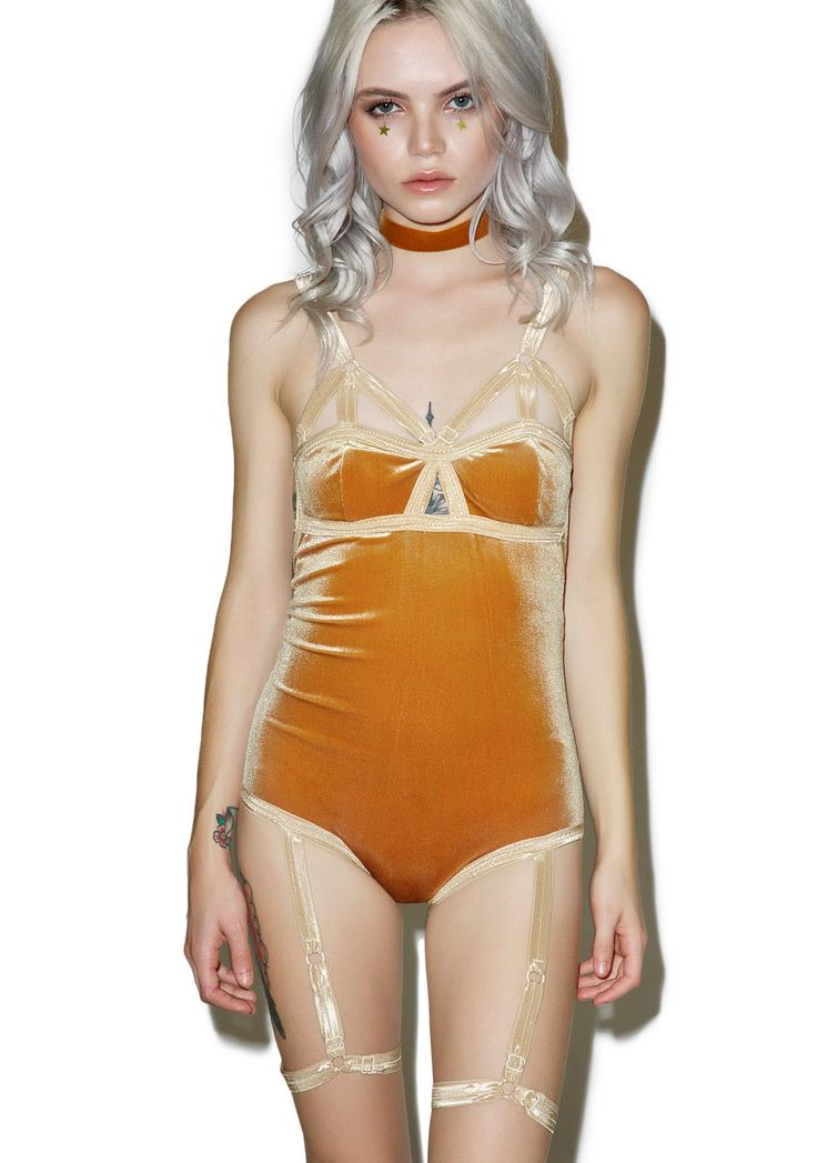 Solstice Intimates Harness Bodysuit cuz yer a lil harlot hottie. This sexxxy lil bodysuit features a plush velvet stretch material that perfectly caresses yer curves with a snug AF fit, cut-out bodice details and a sassy open back. Compete with attached leg harnesses and adjustable straps.