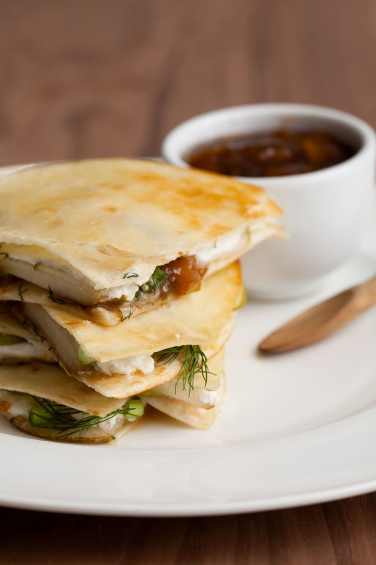 Pear mango and goat cheese quesadilla. These crispy quesadilla's have the yummiest ingredients with flavours balanced just right, tangy goat cheese, fruity mango chutney, and sweet pear. And it's a quick way to treat your family or last minute friends who stop by.