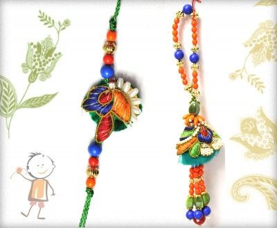 Bhaiya Bhabhi Rakhi, Rakhi Store: - Buy #Bhaiya #Bhabhi #Rakhi #Online On #Rakhi Festival 2015.Delicated Blue-Orange Pearl Bhaiya Bhabhi Rakhi, surprise your loved ones with roli chawal, chocolates and a greeting card as it is also a part of our package and that too without any extra charges. http://www.bablarakhi.com/send-family-rakhi-online/670-send-delicated-blue-orange-pearl-bhaiya-bhabhi-rakhi-online.html