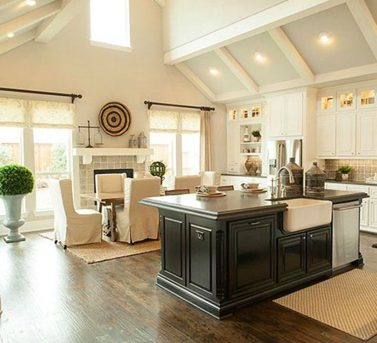 This is EXACTLY the kind of open kitchen / eating area that I love <3 And with the addition of the fireplace it's PERFECT. The rest of the house is pretty nice too :)