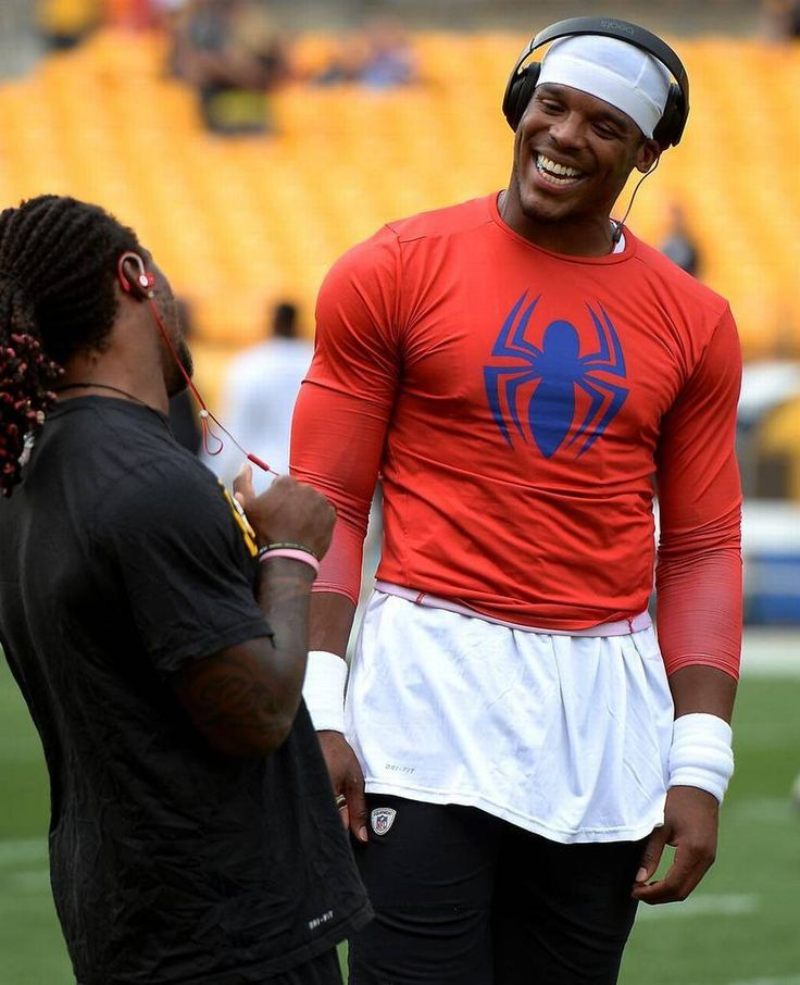 Pittsburgh Steelers running back DeAngelo Williams, left, and Carolina Panthers quarterback Cam Newton, right, talk prior to the team's preseason game on Thursday, September 3, 2015 at Heinz Field in Pittsburgh, PA. Williams formerly played for the Carolina Panthers.