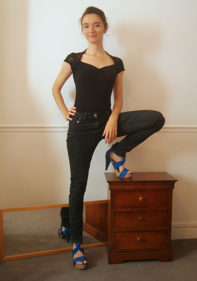 when dressed in black, the top must be tight to suggest restrictive behaviour