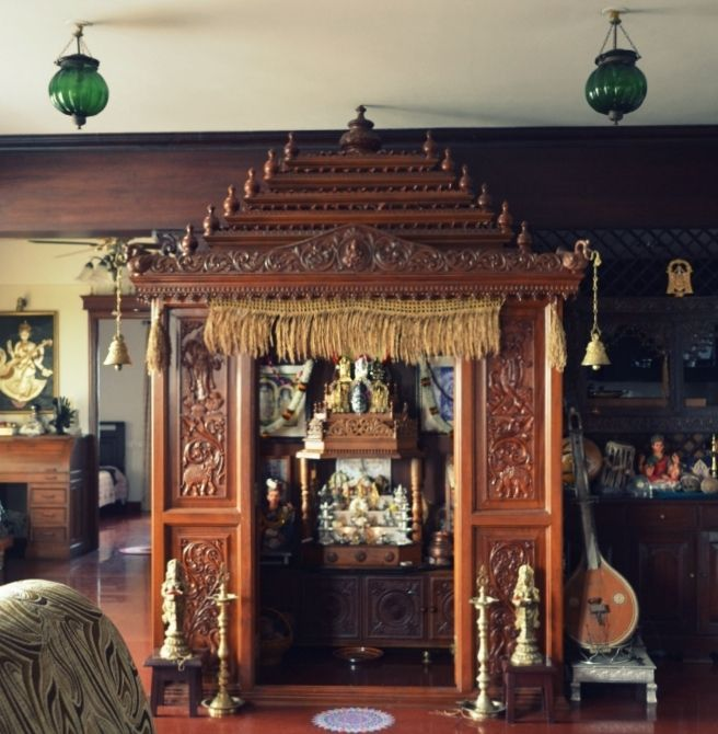 A Traditional South Indian Home With A Beautifully Carved Temple