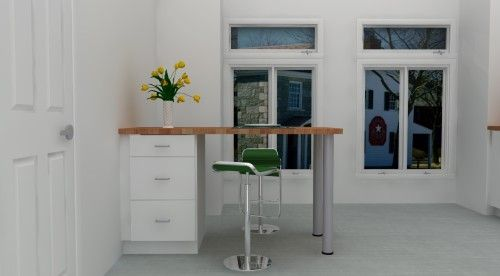 A tiny peninsula doesn't need much. These modern green stools stand out in this IKEA kitchen beautifully.
