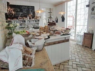 coffee shop/bakery in white - floor looks like it hides a mess