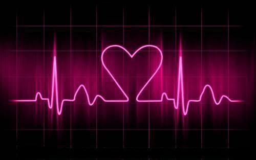Neon pink heart shaped sign