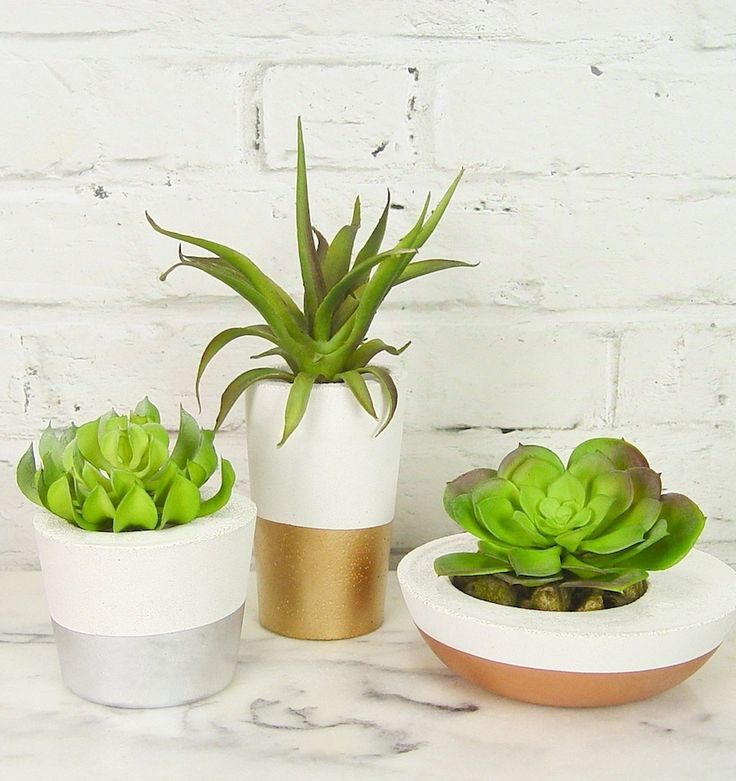 Gorgeous white concrete succulent planters.  White base, dipped in metallic gold, silver and copper.  Available at www.ifoundlove.com.au (http://www.ifoundlove.com.au/concrete-pot-set-white-metallic/)
