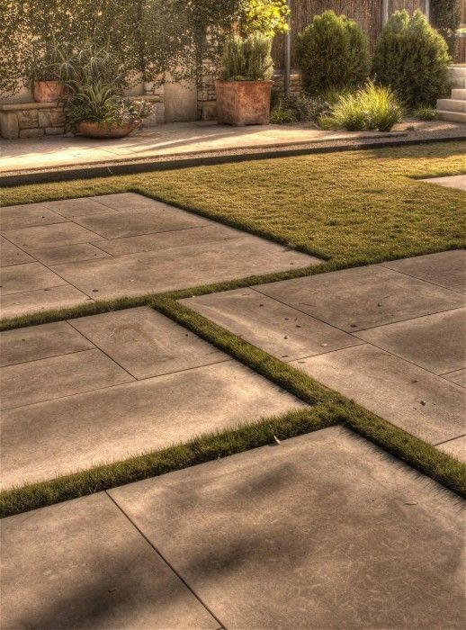 by D-Crain Design and Construction | Austin, Texas | Concrete rectangles with grass in-between.