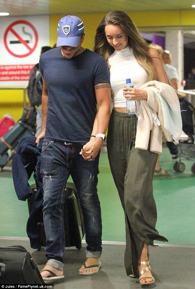Just touched down in London town: Peter Andre and Emily MacDonagh put on an affectionate d...