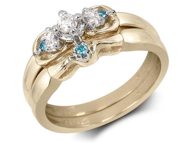 Cross set central diamond3 diamonds on each sideBlue diamond on matching bandCenter diamond weight: .08ct Small diamond weight: 7-.10ct Total diamond weight: .18ct Gold: 14 karat