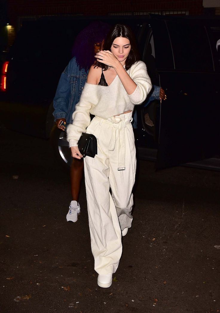 Kendall Jenner in H&M trousers and Givenchy bag.