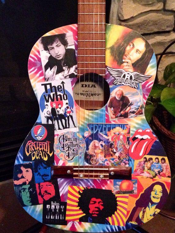 Decoupaged classic rock vintage acoustic guitar