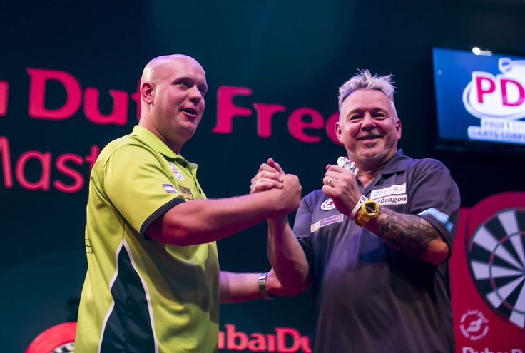 Michael Van Gerwen (NED) and Peter Wright (SCO) during the Dubai Duty Free Darts