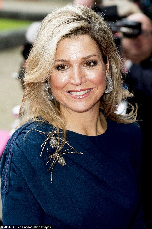 Queen Maxima looked radiant today (Friday) as she stepped out in a navy blue dress enhanced with glitzy accessories