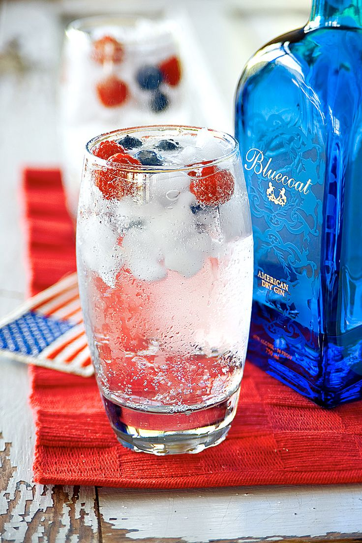 Just whip up a basic gin and tonic and add raspberries and blueberries on top for a pop of color.  Get the recipe at 2eat2drink.   - CountryLiving.com