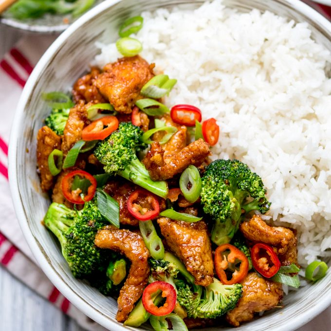 Crispy Chilli Chicken with Brocolli Recipe Main Course with vegetable oil, salt, corn flour, chicken breasts, ginger, garlic cloves, broccoli, lime, dark soy sauce, caster sugar, red chili peppers, spring onions