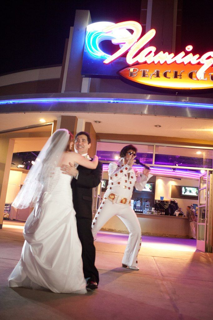 Elvis sings at wedding reception.  Add celebrity impersonator Elvis to your event.  Guests love it!   Call our office today at (702) 365-9526.