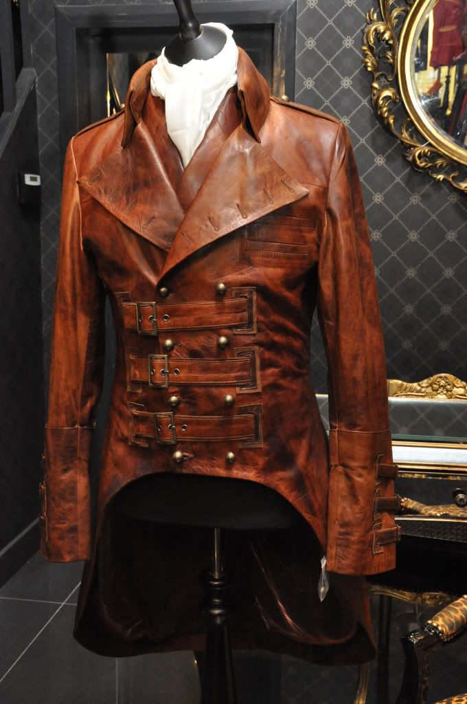 Very Nice!  Whoever made/designed this jacket is very talented! Is it leather?  I like the colors, its not exactly brown nor cordovan either.