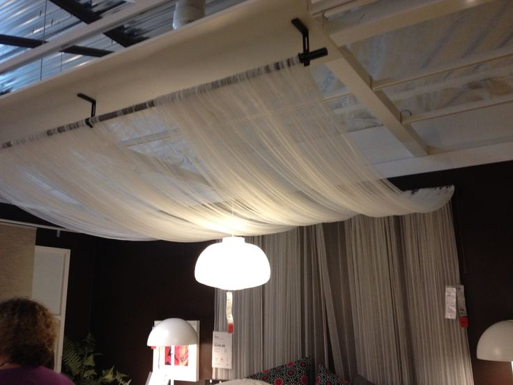 Inspiration from IKEA! Sheer curtains, 2 curtain rods attached to ceiling and voila! A faux canopy bed!