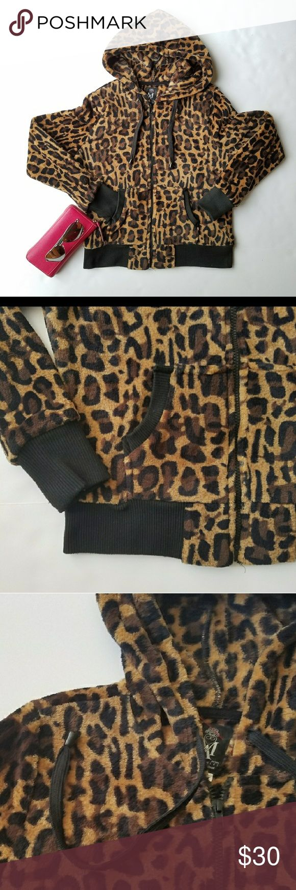 """Leopard Print Zip Front Hoodie Animal print zip front hoodie. Leopard print hoodie. Black sleeve cuff and black ribon around the 2 front pockets edges. Front black zipper. Cozy and warm. Right on trend this season. Size PM. Bust: 20"""" Length: 22"""". EUC,  Like New. 26 International Sweaters"""