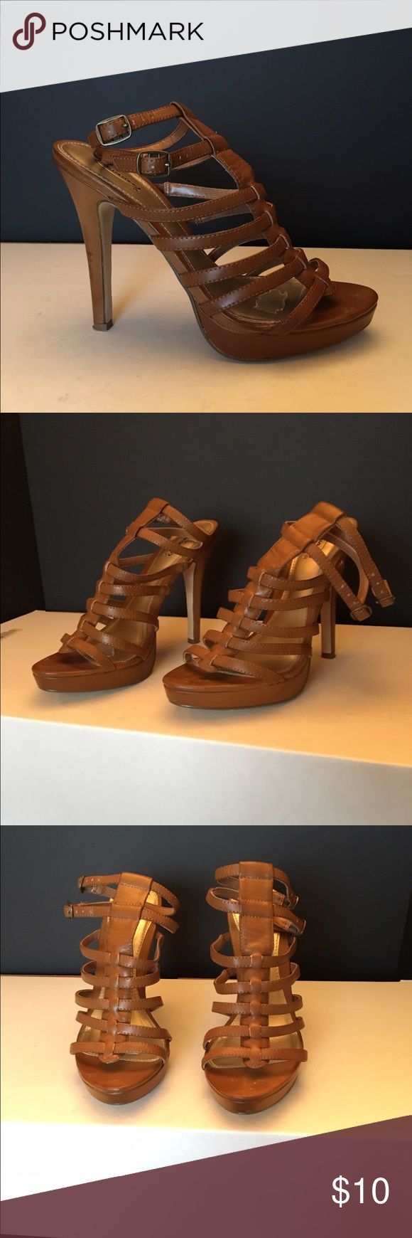 Gladiator High Heel Strappy Sandals Brown Strappy high heel Sandals. Used. Any marks on inner footbed are from foot pads that I added and since removed. Really cute. Shoes Sandals