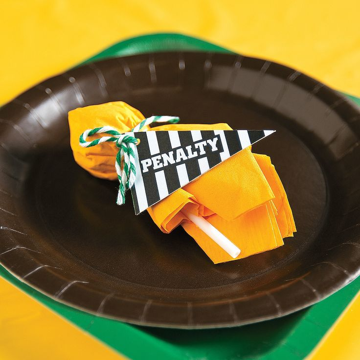 Penalty Flag Suckers Favor Idea | Your  party guests will never decline these penalties! Turn your football party favors into penalty flags with this awesome DIY party project. #footballparty