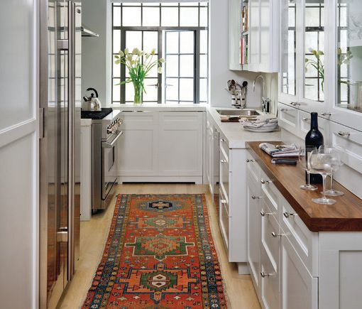Galley Kitchen. Love the white upper and lower cabinets and the deep wood tones for the counters. The only problem with shallow counters is that you can't fit much on them; we'd need to store a lot of our appliances in those cabinets. (Click Pic for 40+ Small/Studio Apartment Ideas)