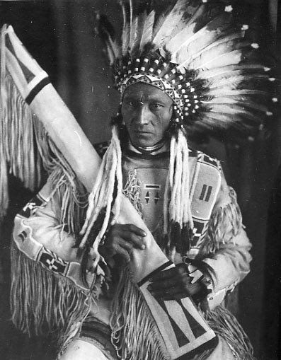 Mike Little Dog - Blackfeet (Pikuni) - 1913. He seems to have a pipe bag in his…