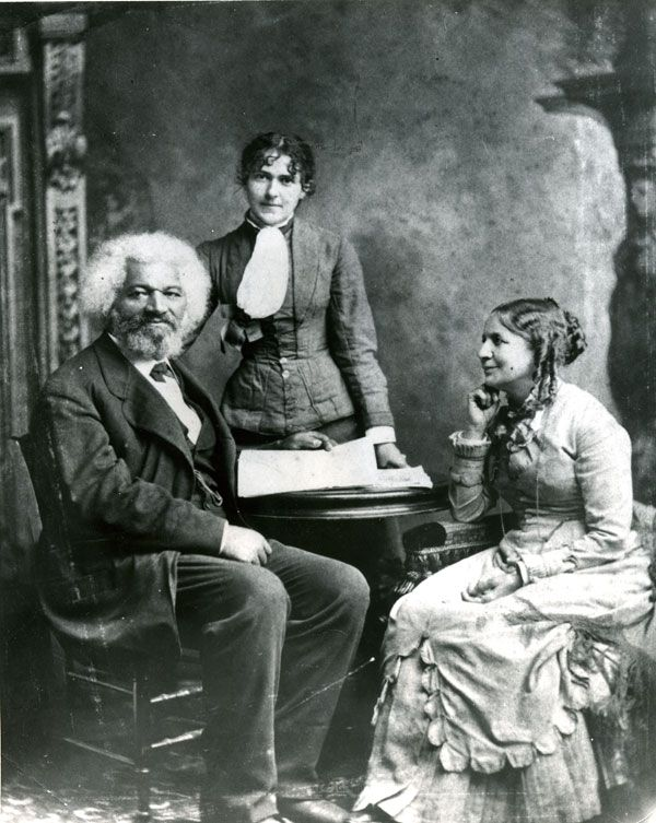 Frederick Douglass reading with his wife & their daughter