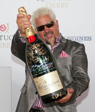 """""""Guy Fieri, have you eaten at your new restaurant in Times Square?"""" New York Times critic Peter Wells writes in his zero-star review of Guy's American Kitchen and Bar."""