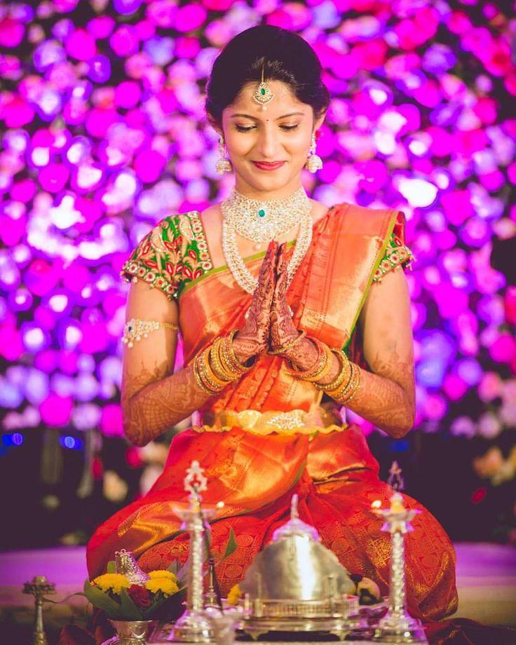 South Indian bride. Gold Indian bridal jewelry.Temple jewelry. Jhumkis. Red orange silk kanchipuram sari.braid with fresh jasmine flowers. Tamil bride. Telugu bride. Kannada bride. Hindu bride. Malayalee bride.Kerala bride.South Indian wedding.