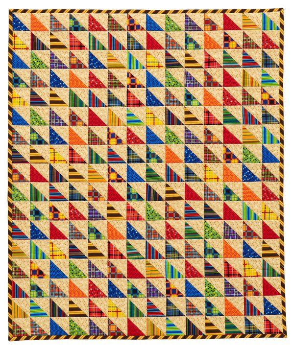 Triangle Quilt Pattern Texture Photos : Triangle-squares in a vibrant mix of colors add plenty of texture to a small quilt. A bias-cut ...