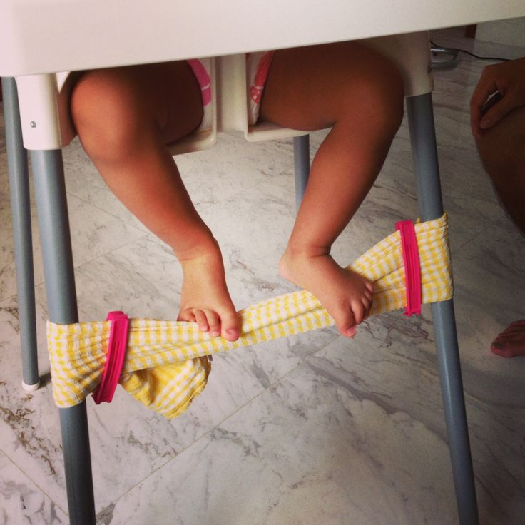 DIY Foot Rest for Ikea Antilop High Chair - secure the ends of a dish towel around the front legs of the chair with 2 food clips. Voila!