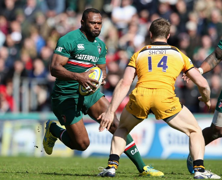 James Short Photos Photos - Vereniki Goneva of Leicester takes on James Short during the Aviva Premiership match between Leicester Tigers and London Wasps at Welford Road on April 12, 2014 in Leicester, England. - Leicester Tigers v London Wasps - Aviva Premiership