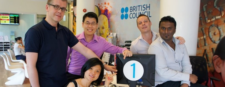 Our Digital Engagement Team (DET) says, 'Just ONE more day to go to London 2012 Olympic Games!'. :-) From left to right: Richard, YC, Regina, Stephen and Poovan.    The DET is committed to delivering Singapore's digital Big Hairy Audacious Goal (BHAG) - 'Digital by Default' across the British Council.    Photograph was taken by Robert Morales at our Napier Road Centre, British Council Singapore. #london2012 — with Richard J Stamper, YC Yeoh, Regina Goh  at British Council Singapore.